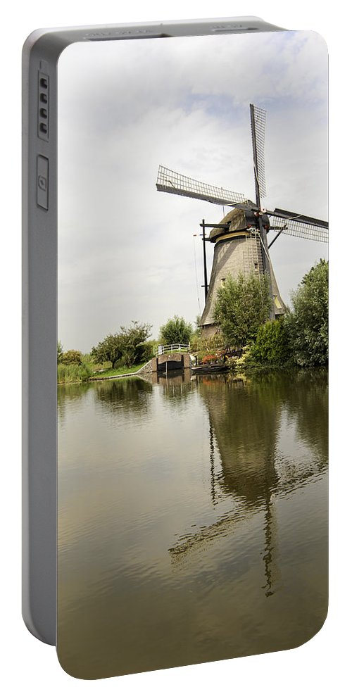 Kinderdijk No 10 Portable Battery Charger featuring the photograph Kinderdijk No. 10 by Phyllis Taylor