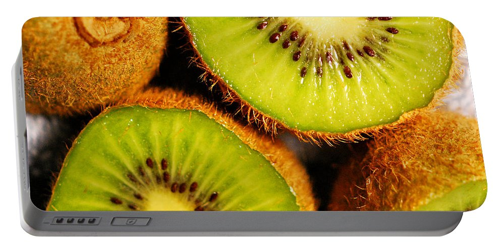 Kiwi Portable Battery Charger featuring the photograph Kiwi Fruit by Nancy Mueller