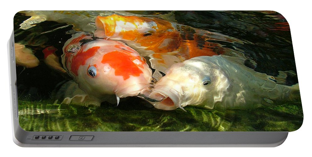 Koi Portable Battery Charger featuring the photograph Koi Ripples by Heather Lennox