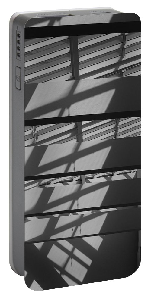 Black And White Portable Battery Charger featuring the photograph Ladders In The Sky by Rob Hans