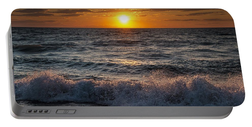 Sea Portable Battery Charger featuring the photograph Lake Michigan Sunset With Crashing Shore Waves by Randall Nyhof