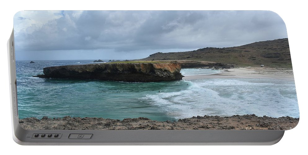 Boca Keto Portable Battery Charger featuring the photograph Large Rock Formation In Aruba's Boca Keto Beach by DejaVu Designs