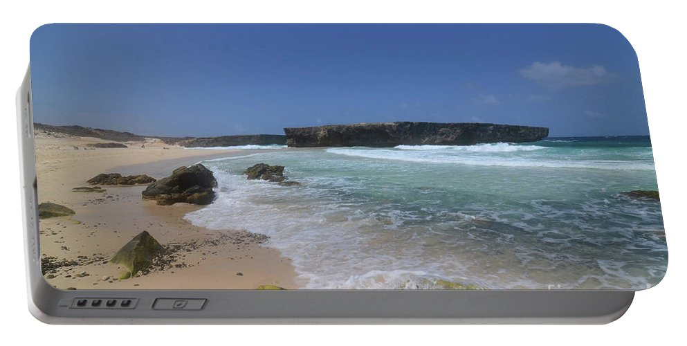 Boca Keto Portable Battery Charger featuring the photograph Large Rock Formation On The Beach At Boca Keto by DejaVu Designs