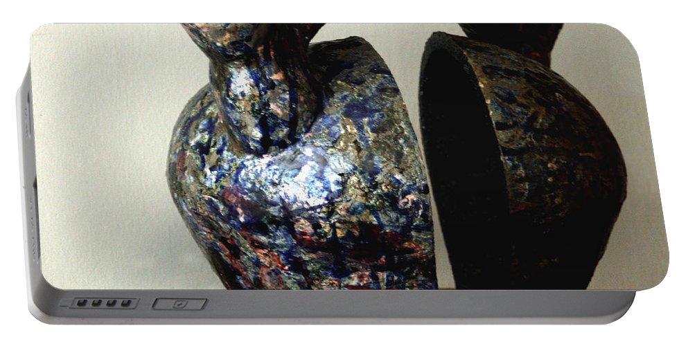Ceramic Portable Battery Charger featuring the sculpture Las Venas Abiertas De America Latina by Madalena Lobao-Tello