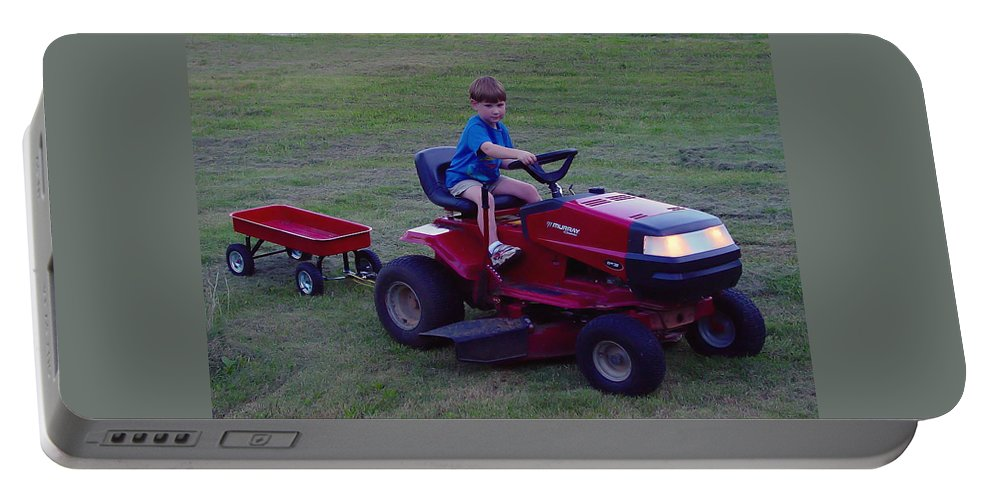 Pat Turner Portable Battery Charger featuring the photograph Lawnmower Boy by Pat Turner