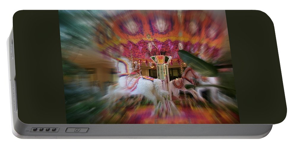 Portable Battery Charger featuring the photograph Le Carousel by Jacqueline Manos