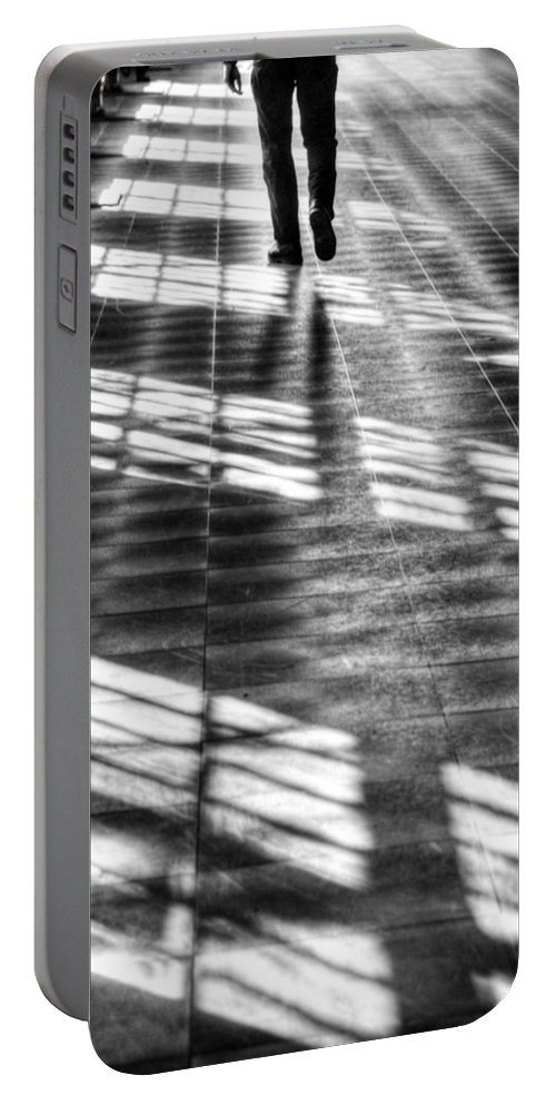 Black And White Portable Battery Charger featuring the photograph Leaving Man by Guna Andersone