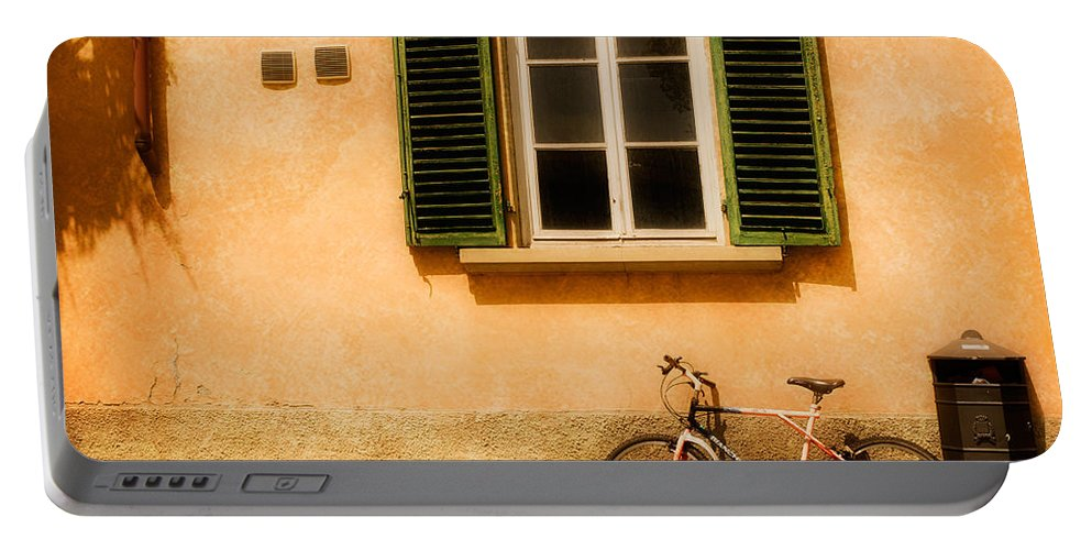 Lucca Portable Battery Charger featuring the photograph Left Flat In Lucca by Mick Burkey