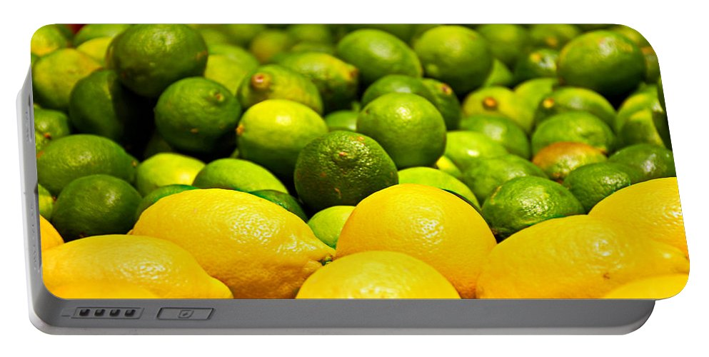 Lemons Portable Battery Charger featuring the photograph Lemons And Limes by Robert Meyers-Lussier