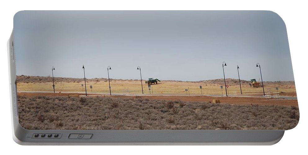 Trackor Portable Battery Charger featuring the photograph Levels Of Land by Rob Hans