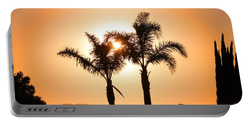 Sunset Portable Battery Charger featuring the photograph Lidia's World Part IIi by Tommy Anderson