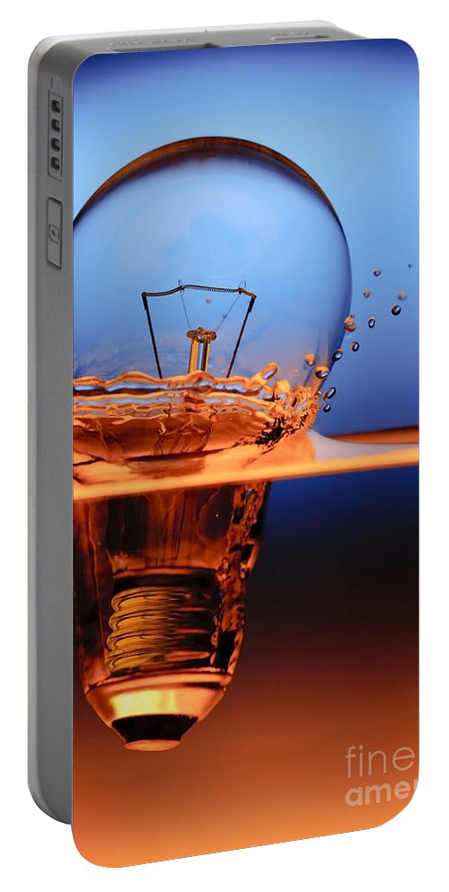 Alternative Portable Battery Charger featuring the photograph Light Bulb And Splash Water by Setsiri Silapasuwanchai