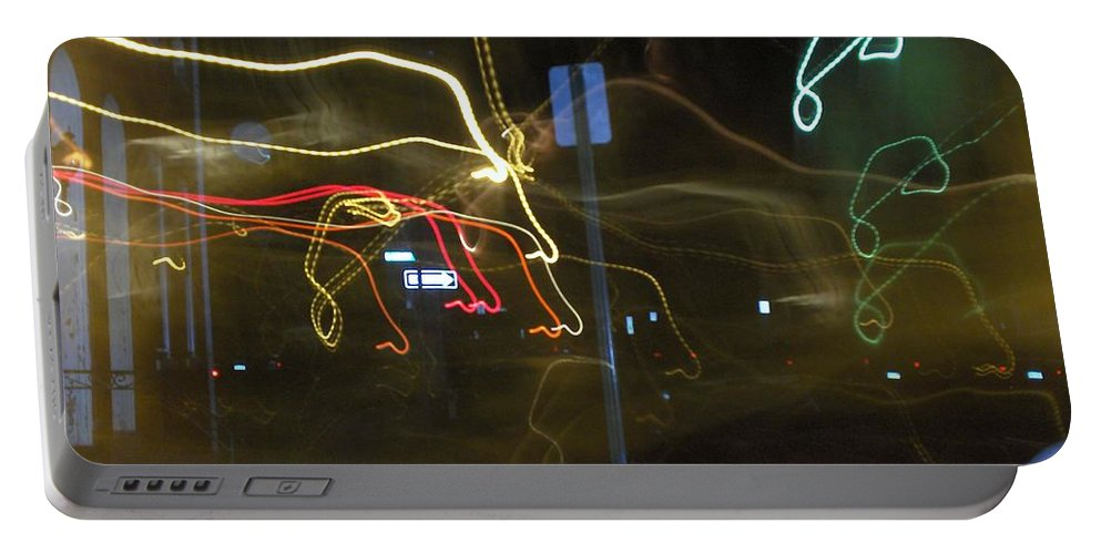 Photograph Portable Battery Charger featuring the photograph Lights That Attack Cars Two by Thomas Valentine