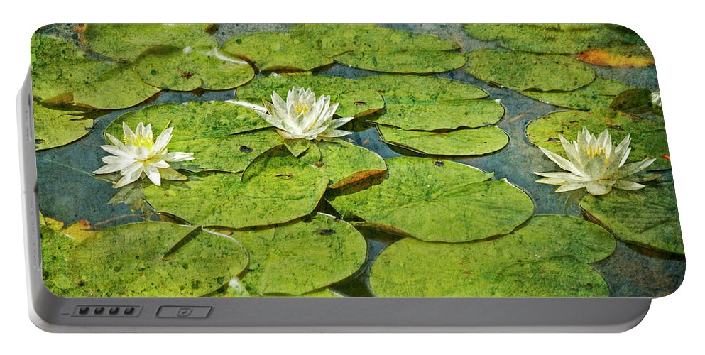 Portable Battery Charger featuring the photograph Lily Pad Flowers by Guy Crittenden
