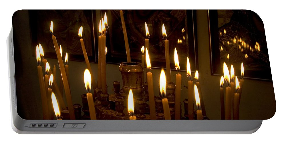 Lit Portable Battery Charger featuring the photograph lit Candles in church by Danny Yanai