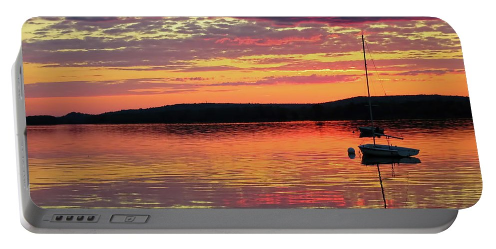 River View Portable Battery Charger featuring the photograph Loan Boat On A River At Sunset by Mark Sellers