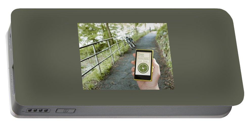 Location Portable Battery Charger featuring the photograph Location-based-apps-mobiloitte by Mobiloitte