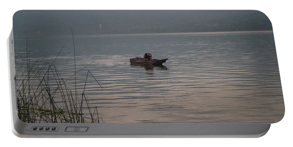 Lone Portable Battery Charger featuring the photograph Lone Fisherman Lake Atitlan by Douglas Barnett