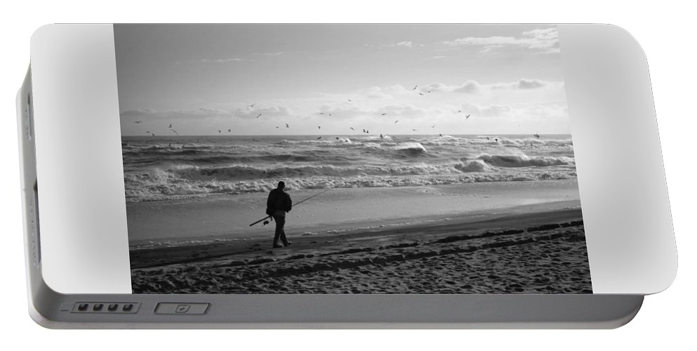 Sea Portable Battery Charger featuring the photograph Lone Fisherman by Linda C Johnson