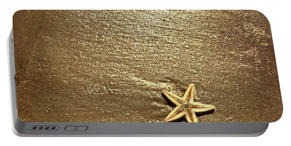 Lone Starfish On The Beach Portable Battery Charger featuring the photograph Lone Starfish On The Beach by Debra Martz