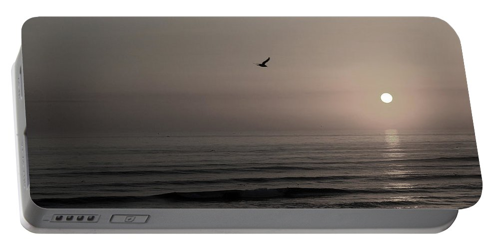 Beach Ocean Wave Sunrise Sunset Sun Bird Gull Fly Flight Water Vacation Peace Nature Relax Peace Portable Battery Charger featuring the photograph Lonely Flight II by Andrei Shliakhau