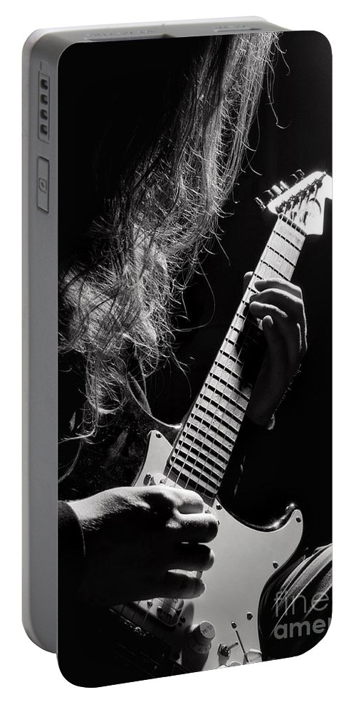 Electric Portable Battery Charger featuring the photograph Long Hair Man Playing Guitar by Arletta Cwalina