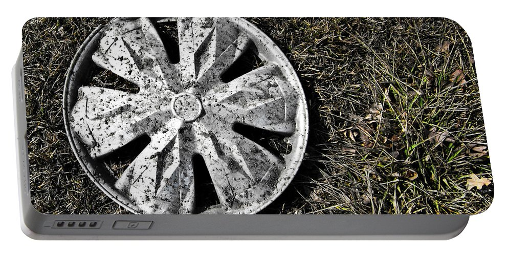 Hub Cap Portable Battery Charger featuring the photograph Lost Hub Cap by Angus Hooper Iii