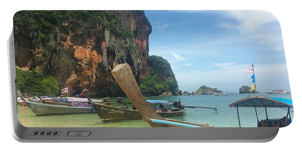 Thailand Portable Battery Charger featuring the photograph Lounging Longboats by Ell Wills