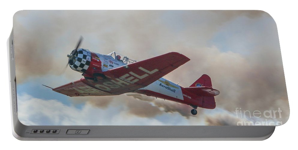 Plane Portable Battery Charger featuring the photograph Low Pass Stunt Plane by Tom Claud