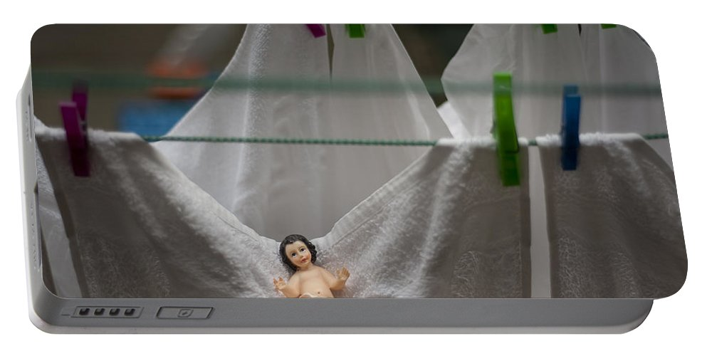 Christmas Portable Battery Charger featuring the photograph Made In China Baby Jesus by Rafa Rivas
