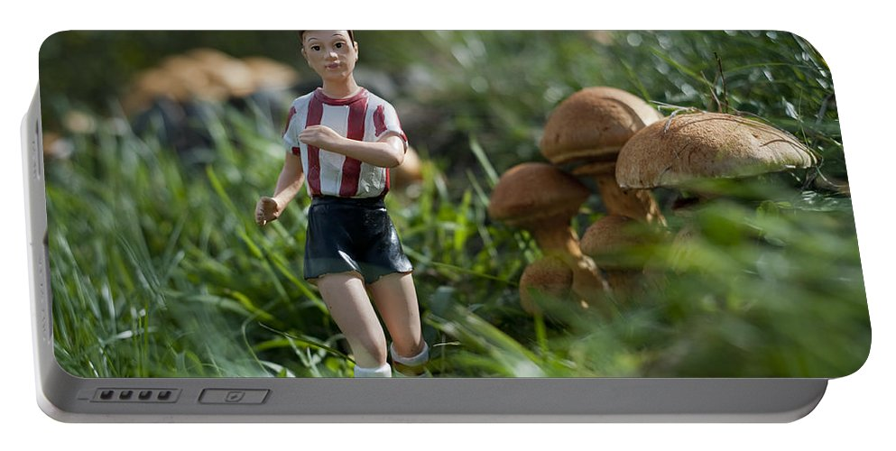 Spain Portable Battery Charger featuring the photograph Made In China Soccer Player by Rafa Rivas