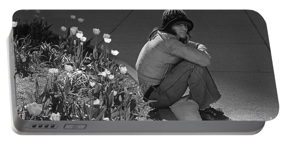 Man Portable Battery Charger featuring the photograph Man Sitting Along Curb by Jim Corwin