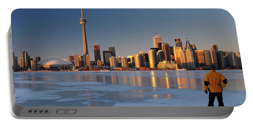 Man Portable Battery Charger featuring the photograph Man Standing On Frozen Lake Ontario Ice Looking At Toronto City by Reimar Gaertner