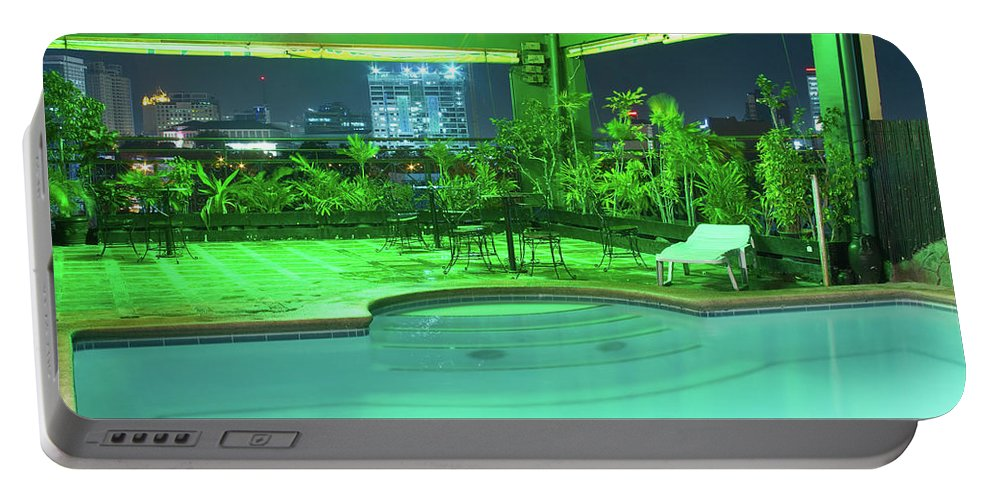 Insogna Portable Battery Charger featuring the photograph Mango Park Hotel Roof Top Pool by James BO Insogna
