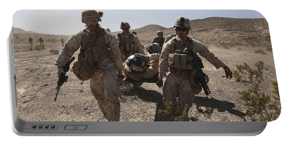 Combat Portable Battery Charger featuring the photograph Marines Transport A Simulated Downed by Stocktrek Images