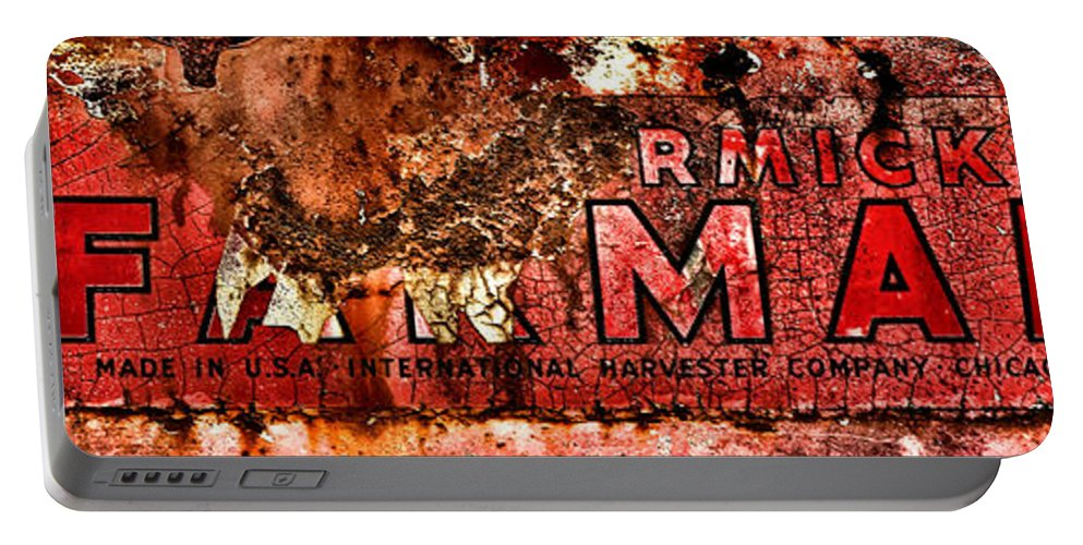 Mccormick Portable Battery Charger featuring the photograph Mccormick Farmall Grunge Logo by Olivier Le Queinec