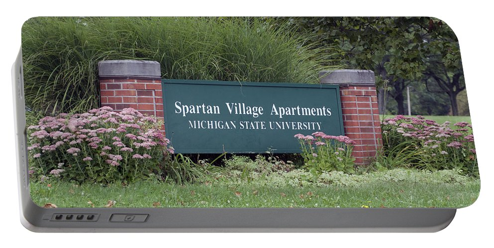 Spartan Village Apartments Portable Battery Charger featuring the photograph Michigan State University Spartan Village Signage by Thomas Woolworth