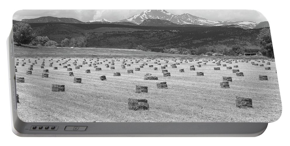 Country Portable Battery Charger featuring the photograph Mid June Colorado Hay And The Twin Peaks Longs And Meeker Bw by James BO Insogna
