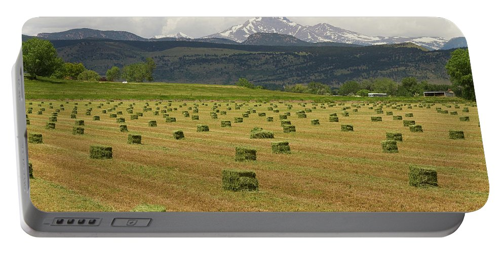 Country Portable Battery Charger featuring the photograph Mid June Colorado Hay And The Twin Peaks Longs And Meeker by James BO Insogna