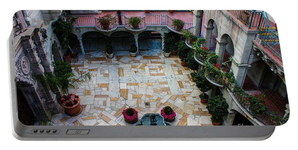 Mission Inn Portable Battery Charger featuring the photograph Mission Inn Chapel Court Yard by Tommy Anderson