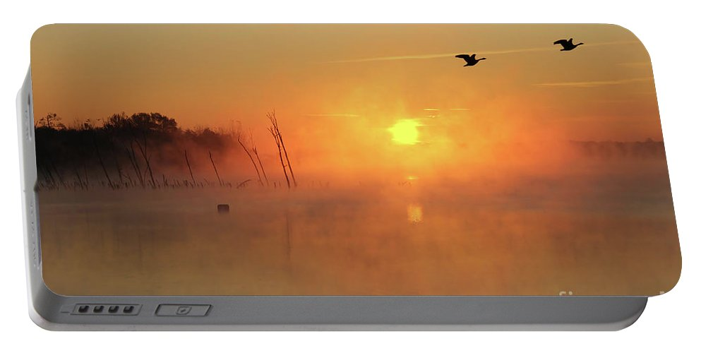 Sunrise Portable Battery Charger featuring the photograph Misty Rise Fly Bye by Roger Becker