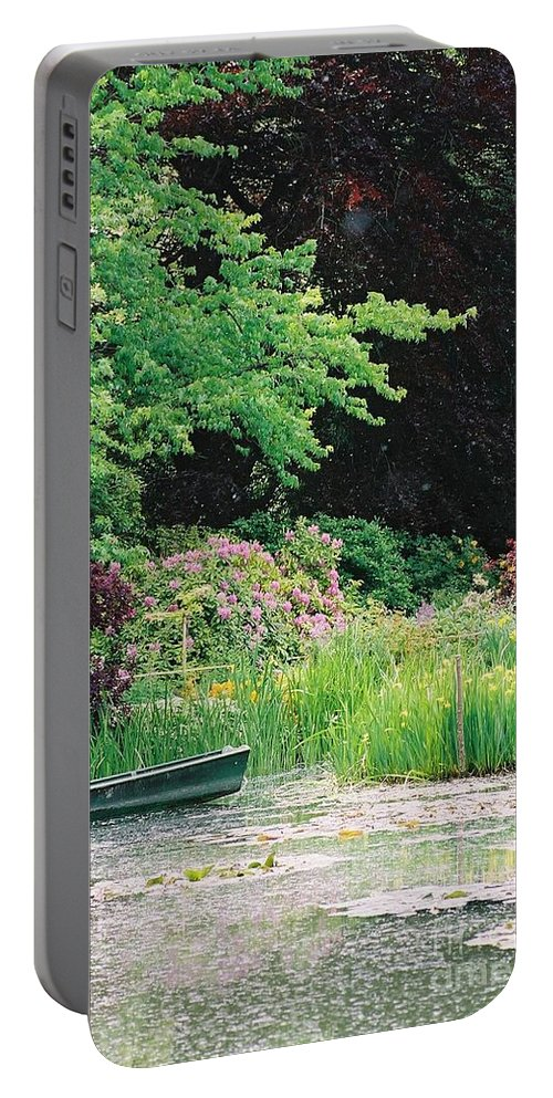 Monet Portable Battery Charger featuring the photograph Monet's Garden Pond And Boat by Nadine Rippelmeyer
