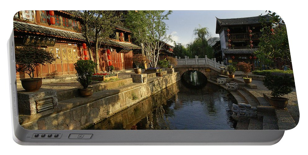 Asia Portable Battery Charger featuring the photograph Morning Comes to Lijiang Ancient Town by Michele Burgess