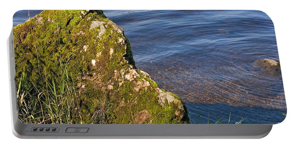 Landscape Portable Battery Charger featuring the photograph Moss Covered Rock And Ripples On The Water by Louise Heusinkveld