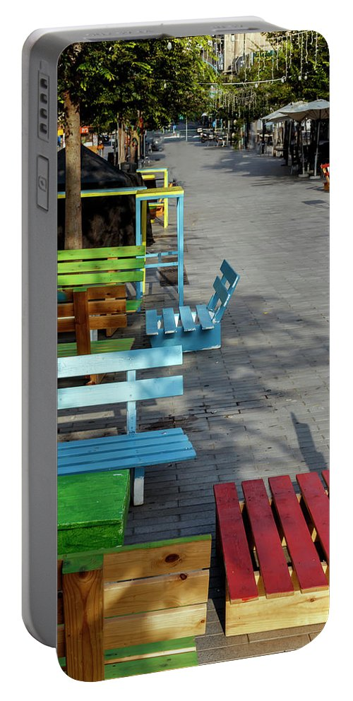 Multicolored Portable Battery Charger featuring the photograph Multi-colored Benches On The Pedestrian Zone by Emma Grimberg