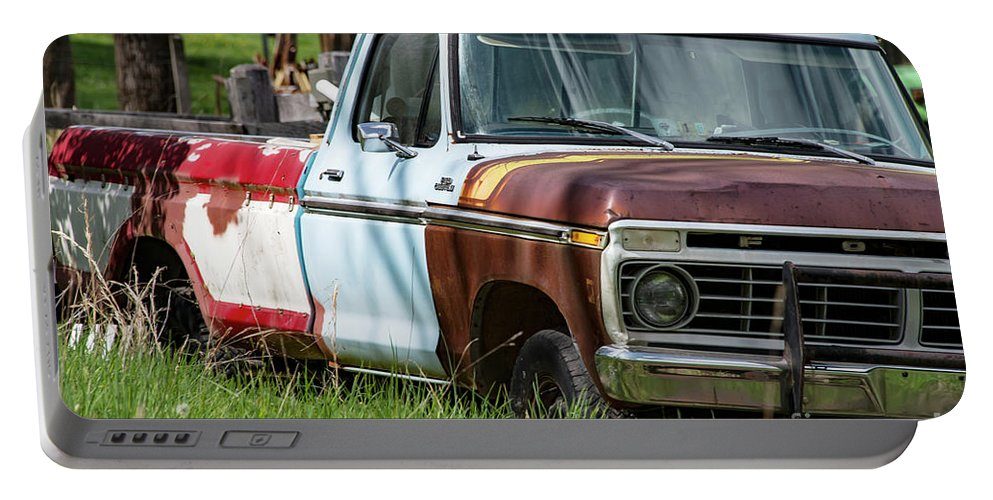 New Castle Portable Battery Charger featuring the photograph Multi-colored Ford by Bob Phillips