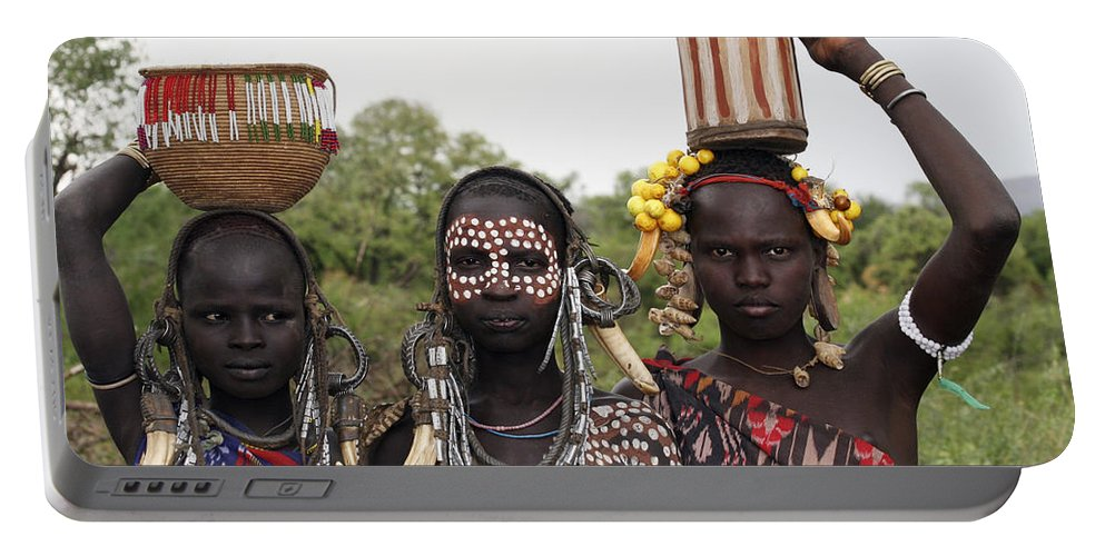 Ethiopia Portable Battery Charger featuring the photograph Mursi Tribesmen In Ethiopia by Gilad Flesch