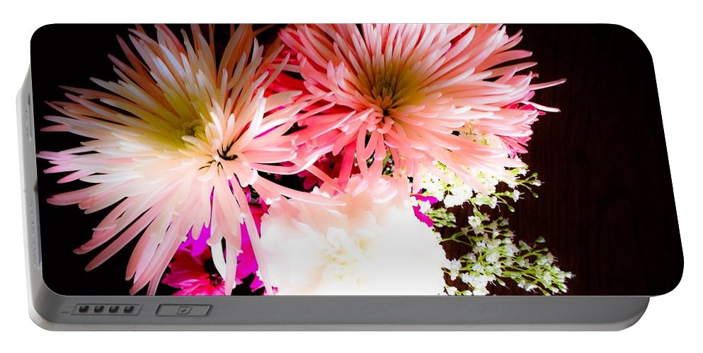 Flowers Portable Battery Charger featuring the photograph Mystery Of A Flower by Debra Lynch