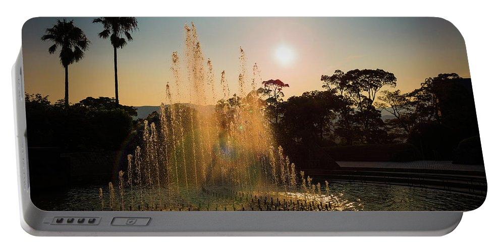 Japan Portable Battery Charger featuring the photograph Nagasaki Peace Park Fountain by Sam Garcia