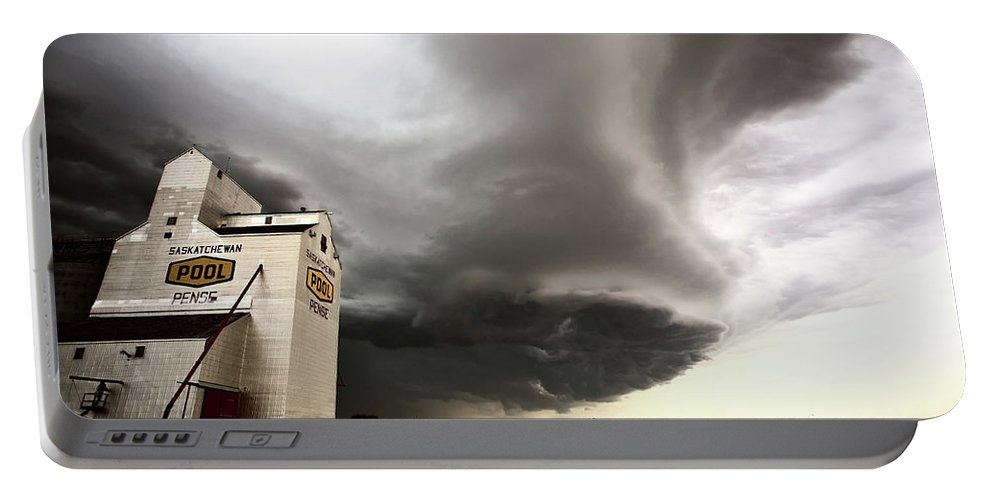 Grain Elevator Portable Battery Charger featuring the digital art Nasty Looking Cumulonimbus Cloud Behind Grain Elevator by Mark Duffy